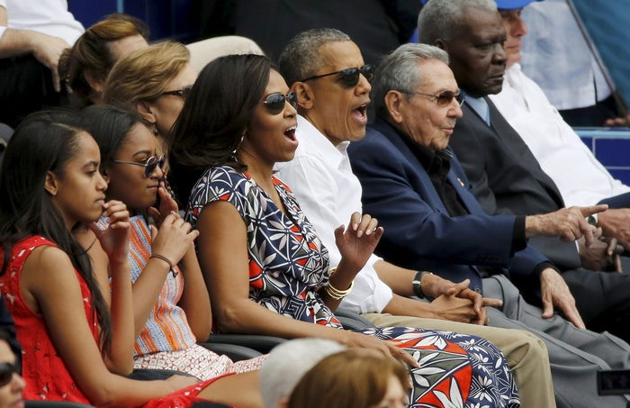 The Obama family, left, and Cuban President Raul Castro, right, at the game Tuesday.