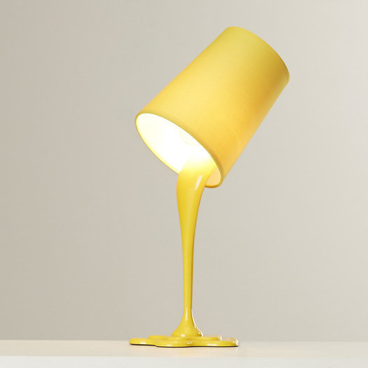 A lamp that appears to be a bucket of paint mid-spill.