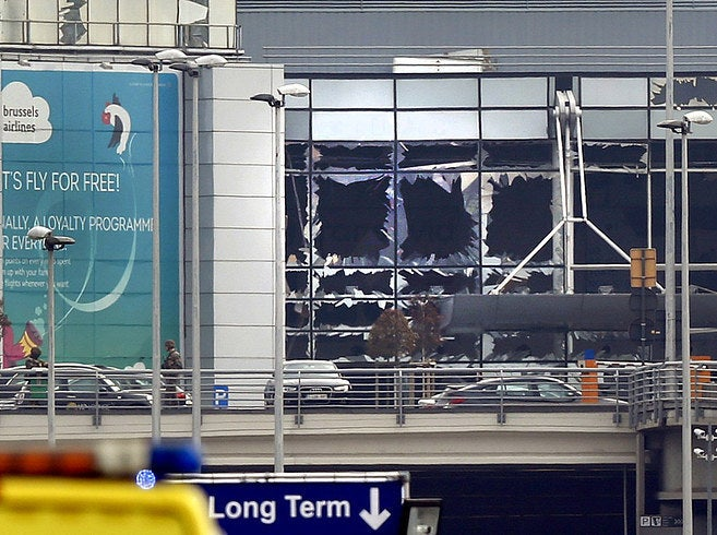 Shattered windows at Zaventum International Airport after an explosion
