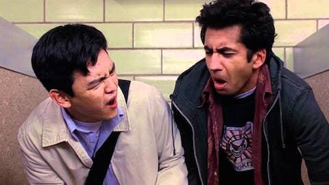 Harold and Kumar making cringey faces in the bathroom