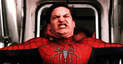 Spider-Man making a cringey face while trying to save a subway car