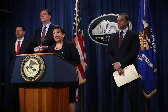 U.S. Attorney General Loretta Lynch speaks as FBI Director James Comey, Assistant Attorney General for National Security John Carlin; and U.S. Attorney Preet Bharara of the Southern District of New York listen on.