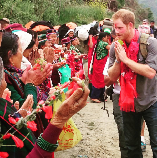 You Guys, This Photo Of Prince Harry Holding A Baby Will