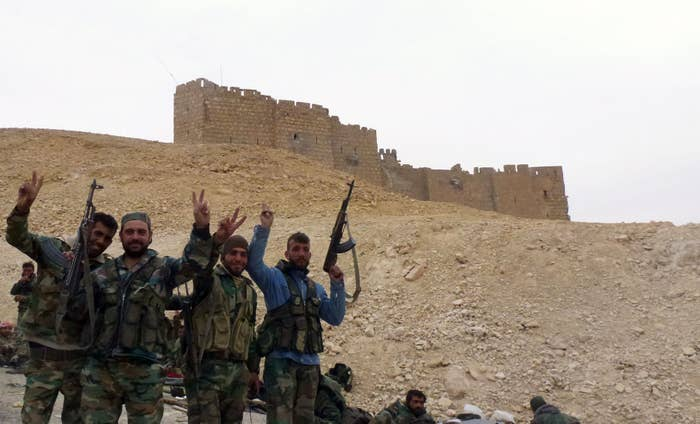 Syrian pro-government forces next to the Palmyra citadel after retaking the city.