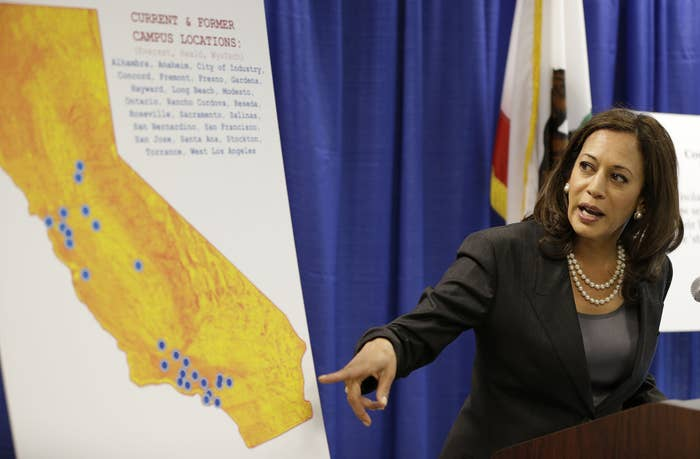 California Attorney General Kamala Harris points to a display showing the location of Corinthian Colleges located in California.