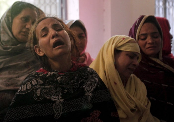 Family members mourn the death of a relative, who was killed in on Sunday in Lahore.