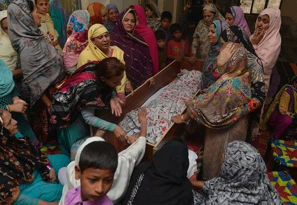 Relatives mourn over the body of a victim following the bombing.