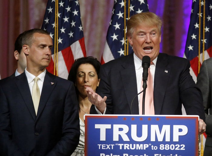 Donald Trump speaks to supporters alongside his campaign manager Corey Lewandowski at his Mar-a-Lago Club in Palm Beach, Fla. on March 15, 2016.