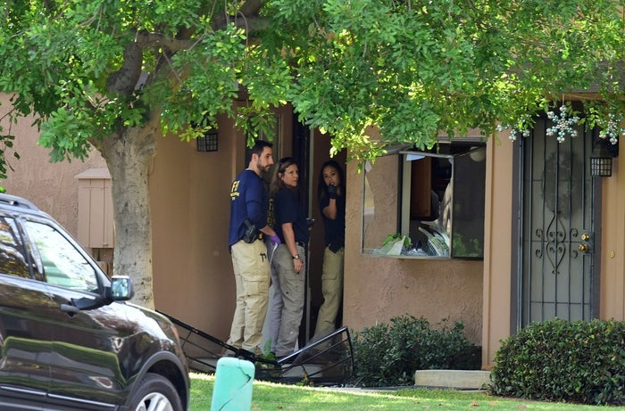 FBI agents investigate the Redlands, California, town home belonging to the attackers.