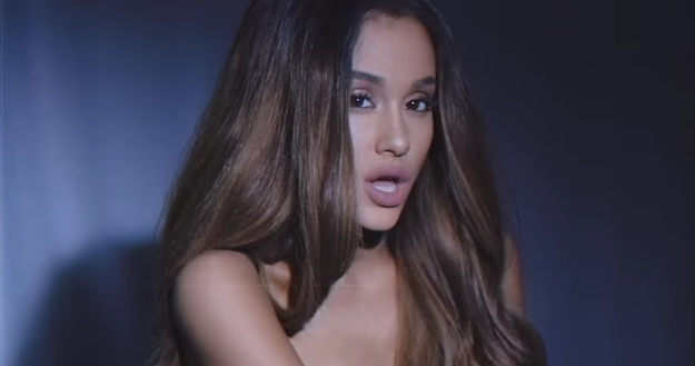 The video features Grande in a series of beauty shots, slowly flipping her hair and flirting with the camera.