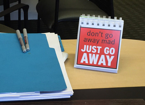 Leave a sign or sticky note on your desk