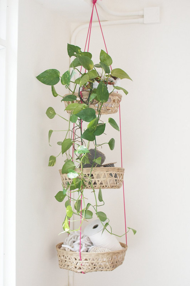 Use rope and inexpensive baskets to string together a colorful plant holder that doubles as storage.