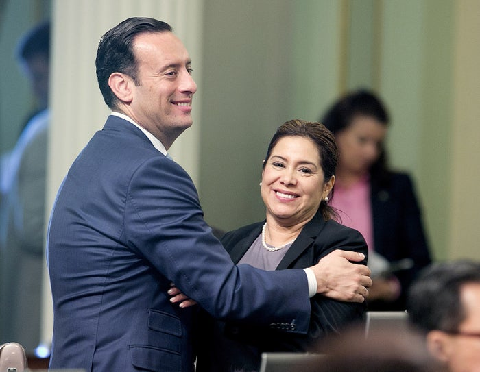 Assemblyman Roger Hernandez, D-West Covina, and Assemblywoman Nora Campos, D-San Jose, celebrate after passing the bill.