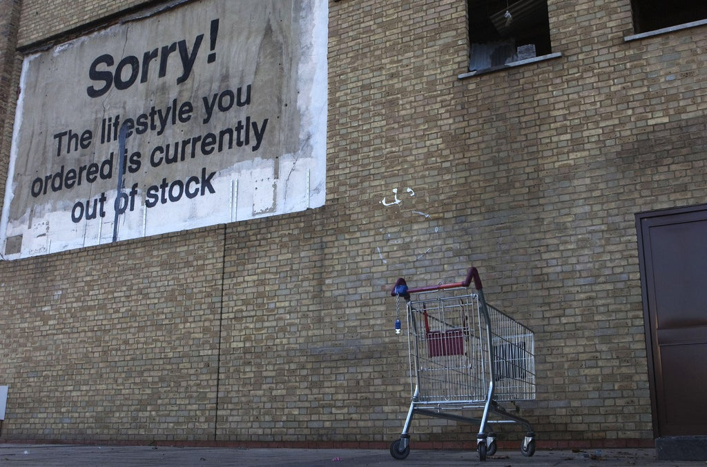 A Banksy piece near Canary Wharf financial district in London.