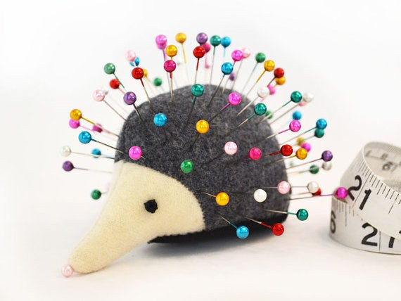 Get this and many differently colored hedgehog pin cushions from greenchildcreations on Etsy for $19.