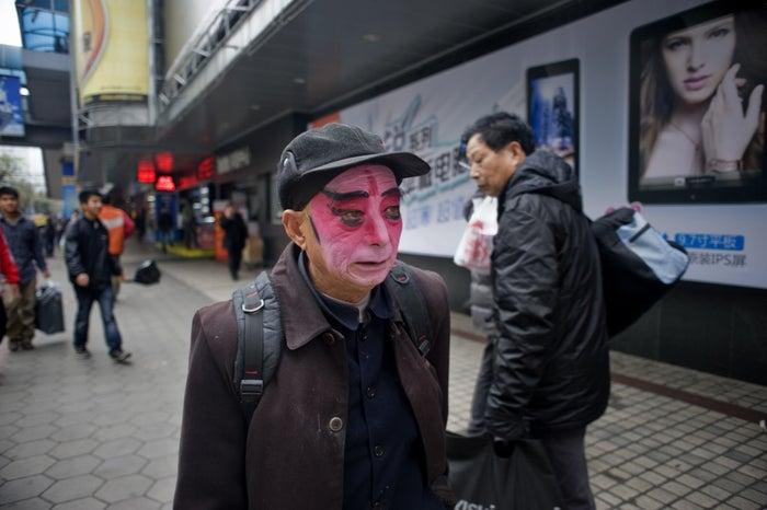 Dairen Huang walks to Zhengjia Mall in Guangzhou, where he will perform Yu Opera with his friends.