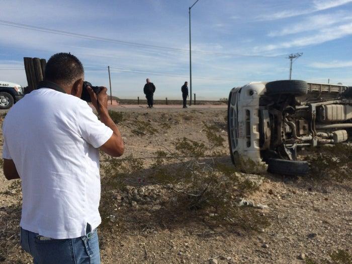 Lucio Soria takes photos at the scene of a car accident