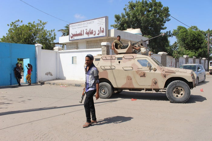 Yemeni security forces outside the elderly care home in Aden on Friday.