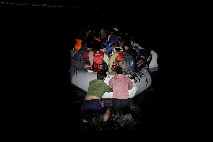 Refugees aboard a dinghy sailing from Turkey to Greece on Saturday.
