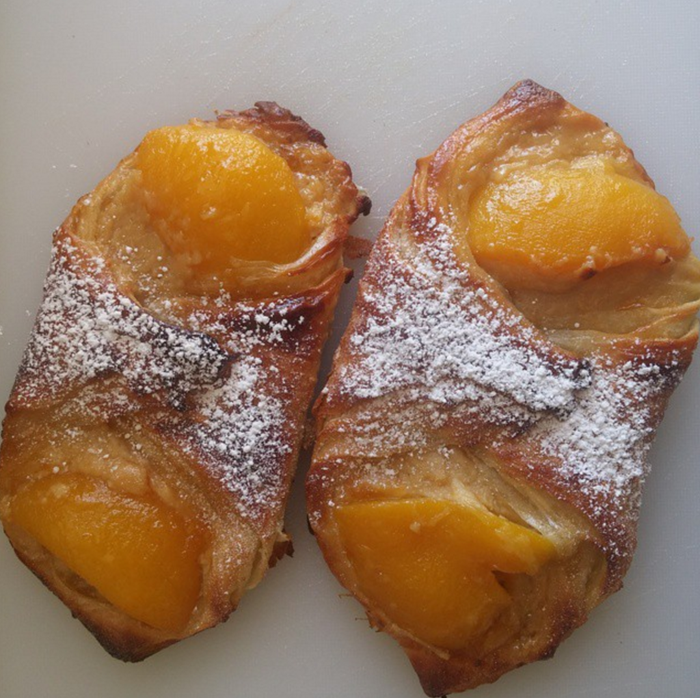 Also called an apricot croissant in some parts of France, the Oranais is a flaky treat filled with custard and topped with two apricot halves.