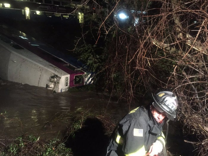 First responders work the scene after the commuter train plunged into Alameda Creek on Monday night.