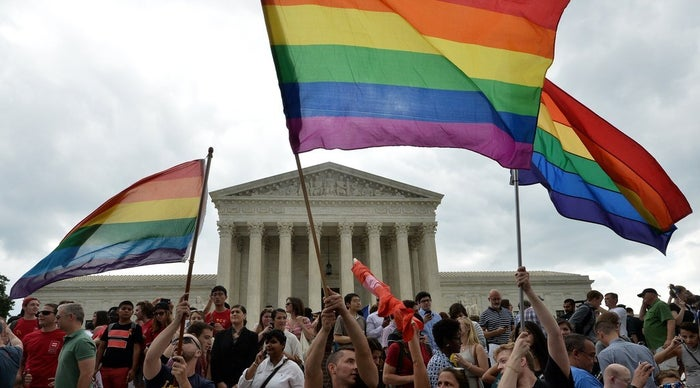 People celebrate outside the Supreme Court in Washington, D.C., on June 26, 2015 after its historic decision on marriage equality.