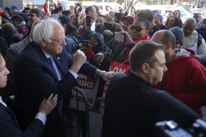 Bernie Sanders greets workers striking against Verizon in Brooklyn, New York April 13, 2016.