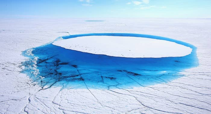Water is seen on the Glacial Ice Sheet that covers about 80% of Greenland in July 2013.