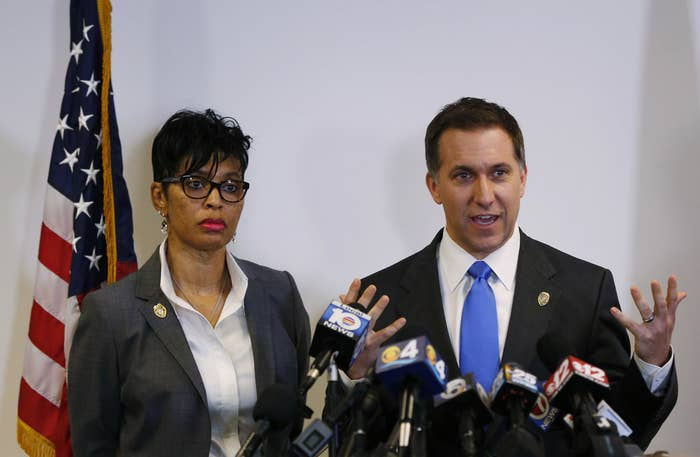 Palm Beach County, Fla. state attorney Dave Aronberg and assistant state attorney Adrienne Ellis speak Thursday during a news conference in West Palm Beach.