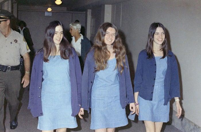 Susan Atkins, Patricia Krenwinkel, and Leslie Van Houten smile and walk to court hearing on Aug. 20, 1970.