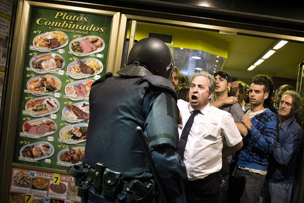 This waiter from Madrid who shielded demonstrators from attacks by anti-riot police.