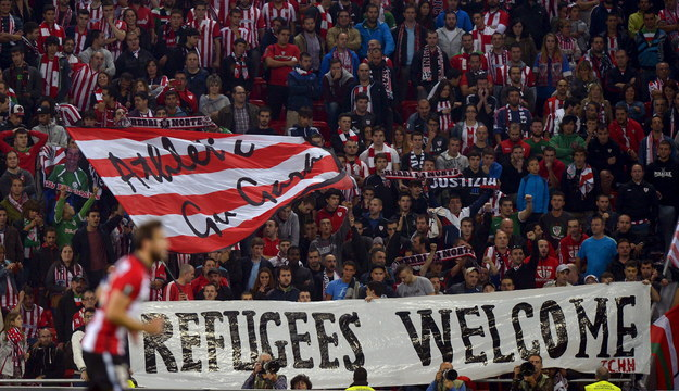 These Athletic de Bilbao fans unfolding a banner welcoming refugees during a UEFA Europa League game.