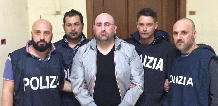 Roberto Manganiello, center.