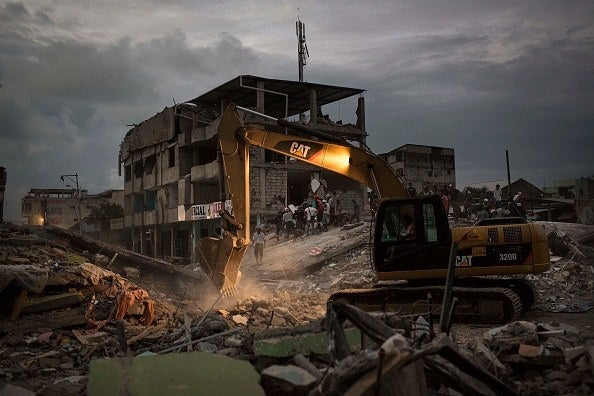 Machinery removes the debris of a collapsed building in Ecuador on Sunday.