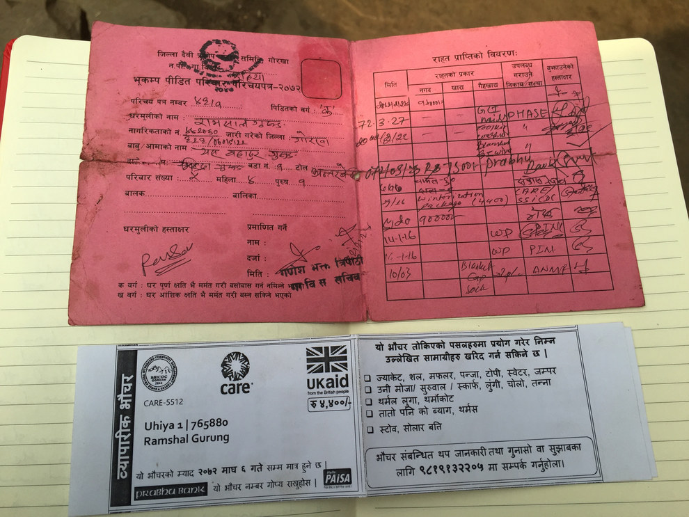 The government issued identity cards to everyone caught up in the tragedy. The card lists details of aid given to victims: Rice - 60 kilogram. Lentils - 9 kilogram. Winterization package (4,400 rupees). Cash - 10,000 rupees. Blankets - 2 pieces.