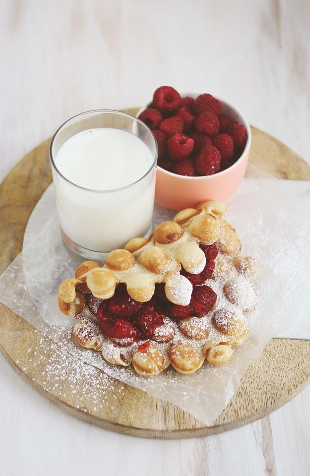Start your day off with peanut butter and fresh raspberry jam waffles.