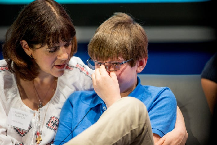 "Christopher Relyea, 12, is comforted by his mother after incorrectly spelling ""vexillology"" during the preliminaries of the 2015 Scripps National Spelling Bee."