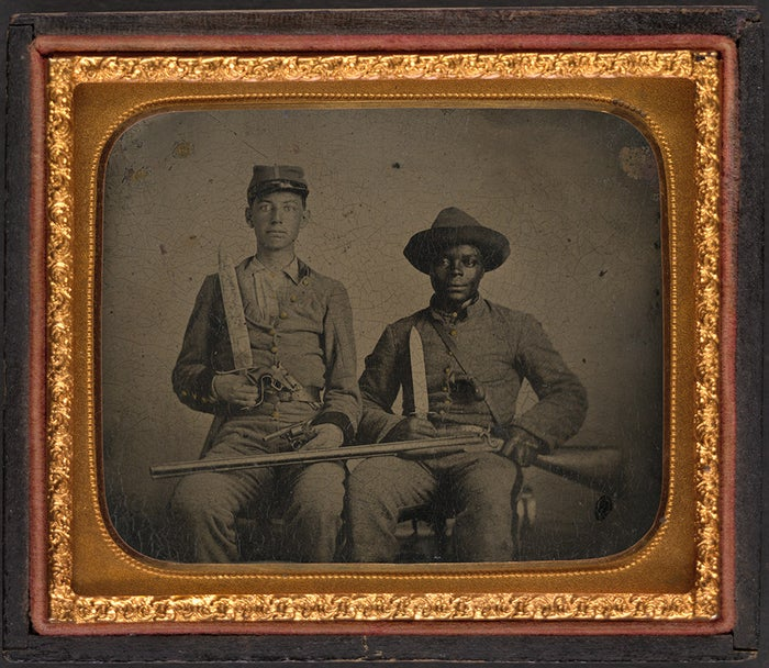 A 160-year-old tintype depicting Andrew Chandler and his slave Silas, both in Confederate uniform, has long been used as evidence that slaves willingly fought against the army that aimed to free them. Following the national backlash against Confederate iconography, Silas's descendants share their story with Adam Serwer in order to debunk the myth once and for all. Read it at BuzzFeed News.