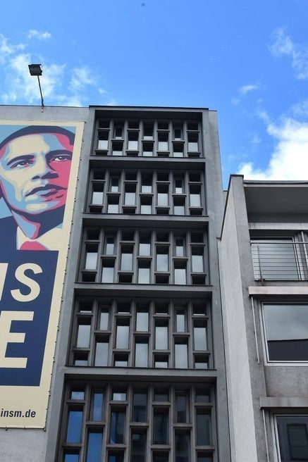 A protest banner in Germany, where Obama visits after his UK trip
