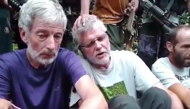 Canadians Robert Hall (left) and John Ridsdel are seen in this still image taken from an undated militant video.