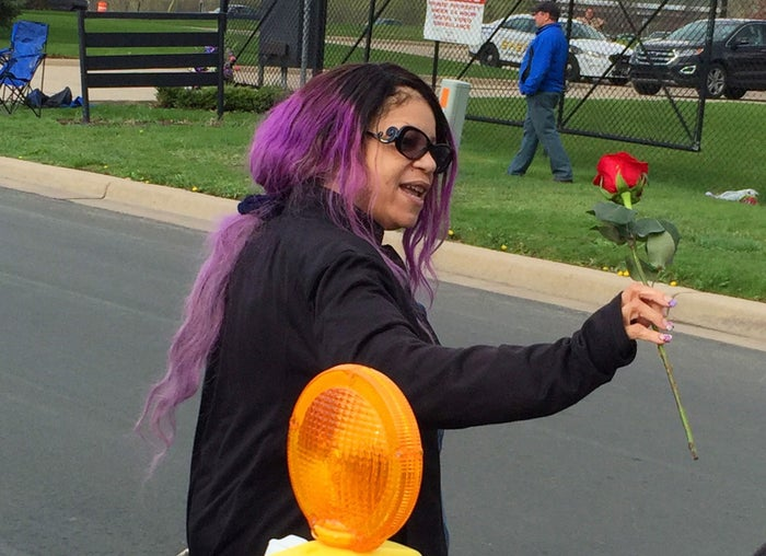 Tyka Nelson holds a rose outside Paisley Park.