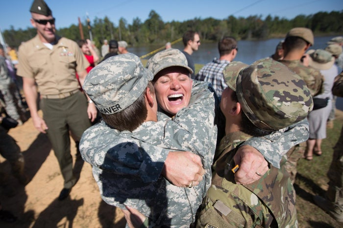 Maj. Lisa Jaster (center) embraces First Lt. Shaye Haver (left) and U.S. Army Capt. Kristen Griest (right) after an Army Ranger School graduation ceremony.