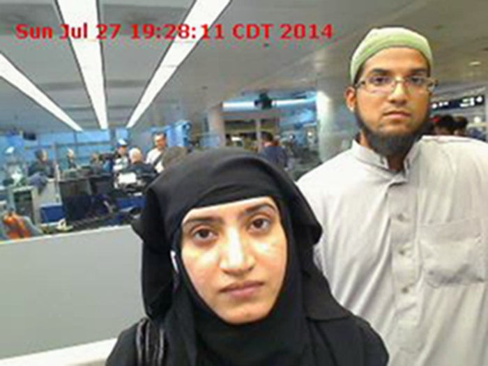 Tashfeen Malik, left, and Syed Farook, as they passed through O'Hare International Airport in Chicago.