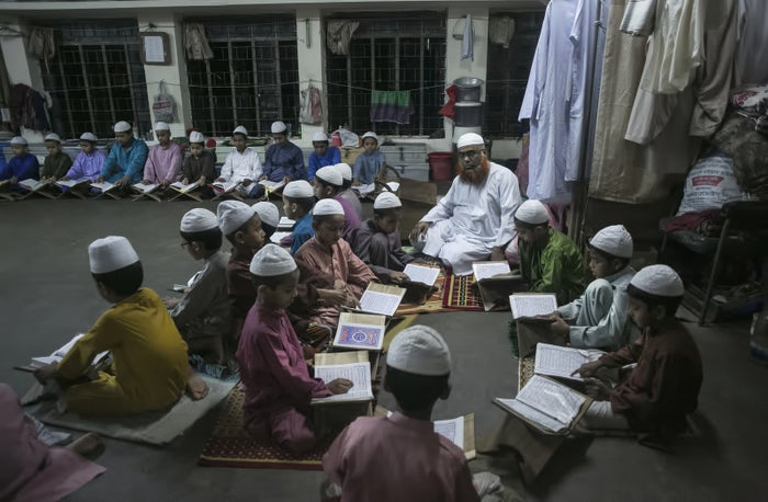 "Boys study at the Jamia Rahmania Arabia madrassa, where Mufti Jasim Uddin Rahmani used to teach, on March 22, 2016 in Dhaka, Bangladesh. Rahmani is remembered as the ""jihadist cleric"" at the Hatembagh Jame Masjid where he led prayers and at the Jamia Rahmania Arabia madrassa where he used to teach."