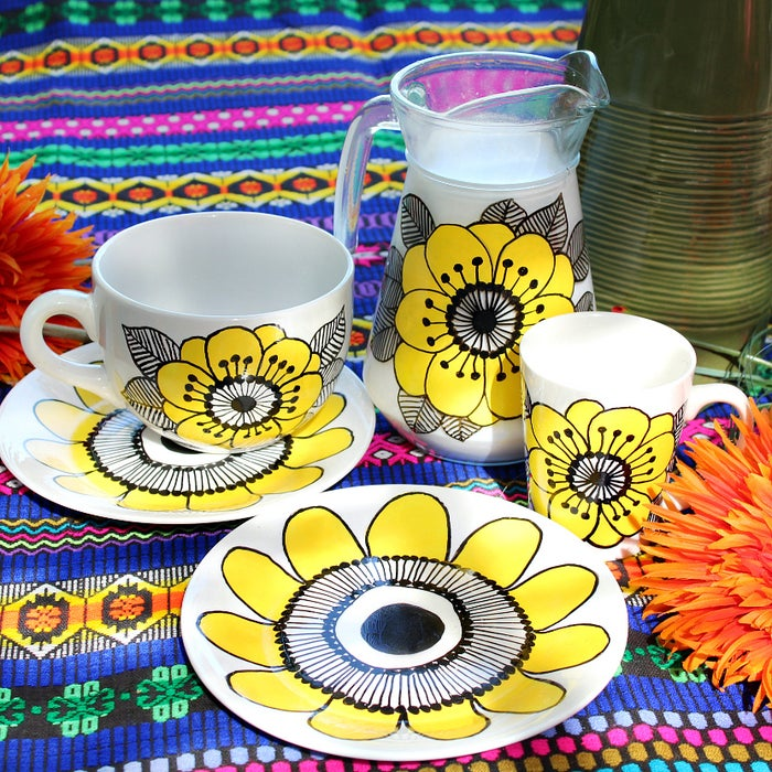 They're not supposed to look perfect, and you can erase with rubbing alcohol if you mess up! New Markimekko dishes can cost $38.50 for a single plate. Get the tutorial here.