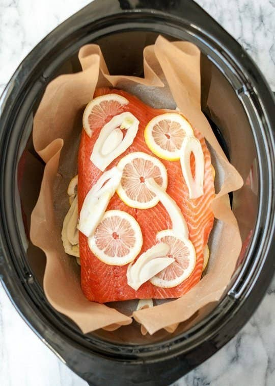 Line the slow cooker with parchment paper before cooking so you can easily lift out the salmon in one piece once its done. Recipe here.