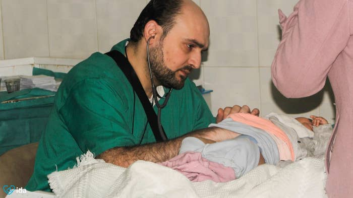 Dr. Moaz with a patient in Aleppo in February.