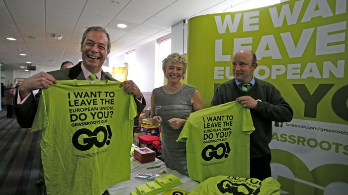 UKIP leader Nigel Farage shows off some Grassroots Out merchandise
