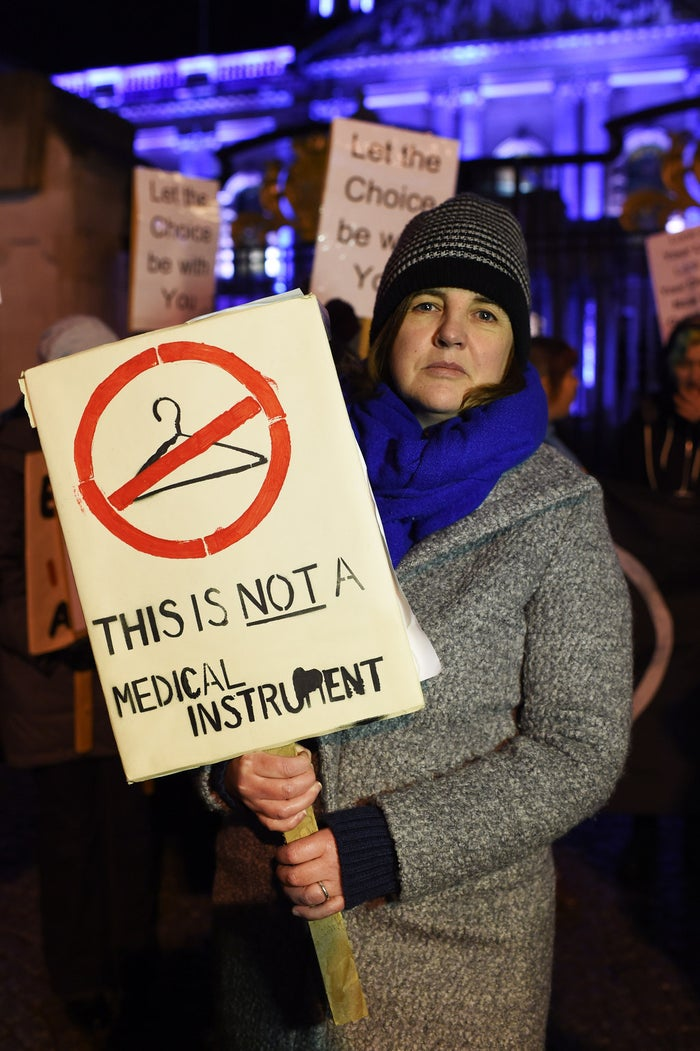 A woman stands with a placard as pro–abortion rights activists rally outside City Hall on 15 January 2016 in Belfast, Northern Ireland.