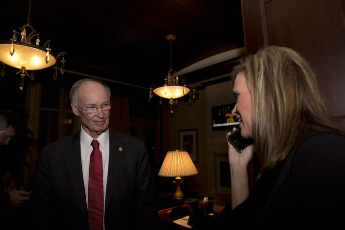 Gov. Robert Bentley listens to a phone call as Rebekah Mason announces his win for Alabama governor in 2014.